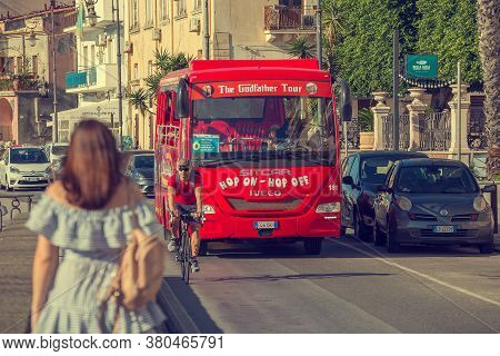 Giardini Naxos, Sicily, Italy - September 26, 2019: Red Tourist Bus Hop On Hop Off Godfather Tour Is