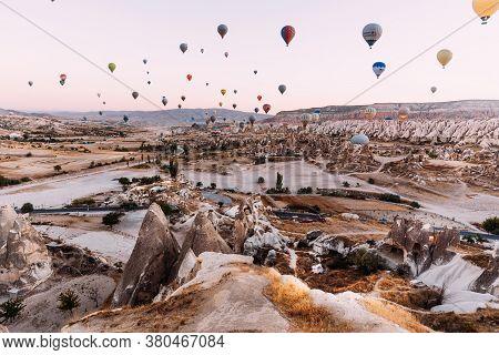 Turkey, Cappadocia - October 10,2018: Early Morning In Cappadocia, The Flight Of Balloons. A Large N