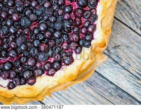 Macro View Of Open Homemade Pie With Summer Berries On A Wooden Table. Top View. Tart With Berries.
