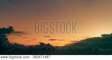 Beautiful Golden Sunset Sky And Dark Clouds. Sky In The Evening With Yellow And Orange Light From Th