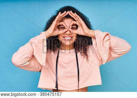 Cheerful Excited African American Woman With Black Curly Hair Showing Ok Gestures With Both Hands Pr