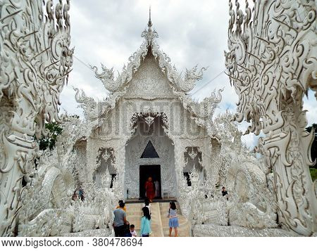Chiang Rai. Thailand, June 17, 2017: Wat Rong Khun. People At The Entrance Of The White Temple In Ch