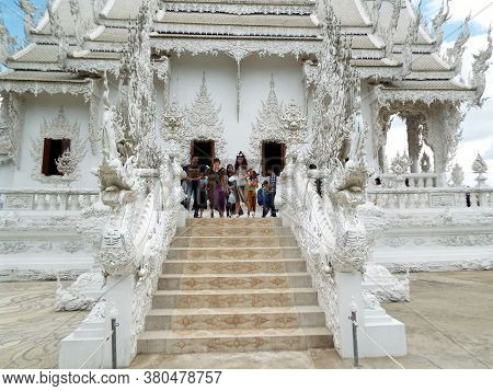 Chiang Rai. Thailand, June 17, 2017: Wat Rong Khun. People Prepare To Go Down One Of The Side Stairs