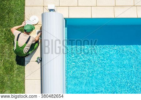 Recreation Industry Theme. Residential Outdoor Swimming Pool Skimmer Filter Cleaning By Professional