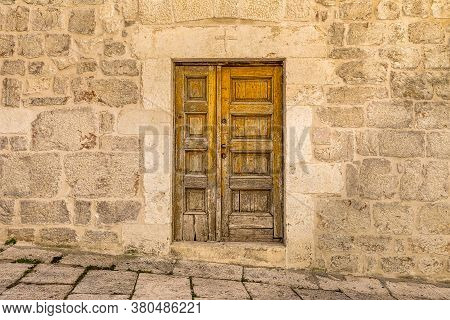 Ancient Wooden Door On A Street In Sibenik. A Historic Town On The Dalmatian Coast Of Adriatic Sea I