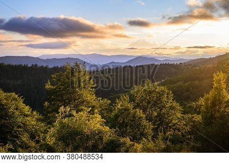 Sunset In Mountain Landscape. Mountain Layers In Sunset. Sunset In The Mountain Forest Landscape. Fo