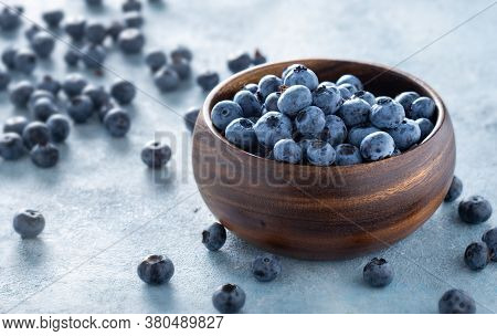 Fresh Blueberries In Wooden Bowl Copy Space Close Up