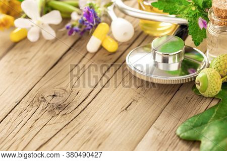 Natural Herbal Medicine Concept Stethoscope With Various Plants Leaves Of Healing Herbs Capsules And