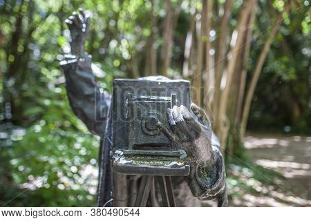 Bronze Statue Of Photographer With Old Large Camera At Campo Grande, Public Park Located In Valladol