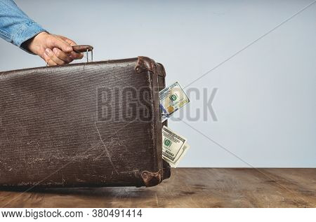 Retro Suitcase With Money In Hands Of Man. Corruption And Bribery Concept