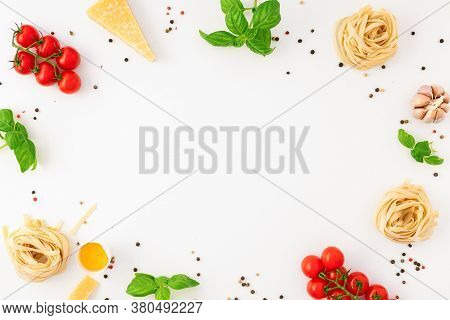 Frame Of Fettuccine With Ingredients For Cooking Italian Pasta On White Background Top View Flat Lay