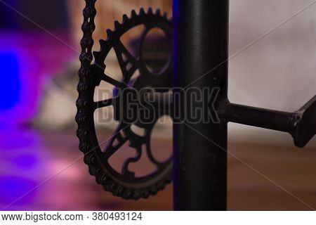 Machinery Powered By Chain Gear. Chain And Gears - Neon Background