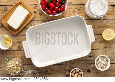 Baking Dish With Ingredients For Cooking Cherry Pie Wooden Table Top View