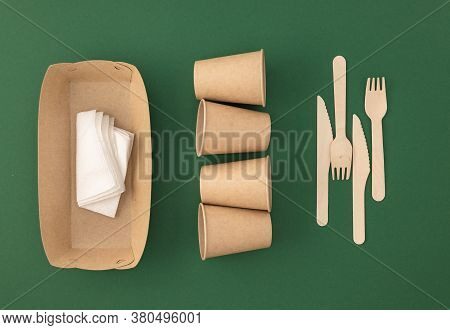 Zero Waste, Plastic Free Concept. Disposable Paper Cups With Wooden Forks And Knives Eco Sustainable