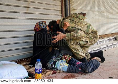 Aleppo, Syria, 26 March 2017: An Old Woman Kisses The Head Of A Warrior, A Woman Kisses Her Son's He