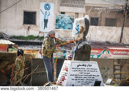Aleppo, Syria, 26 March 2017:\na Fighter From The Syrian Opposition Tries To Break Down A Statue, Br