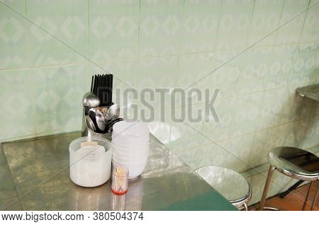 Flatware and Bowls on Table in Cafe