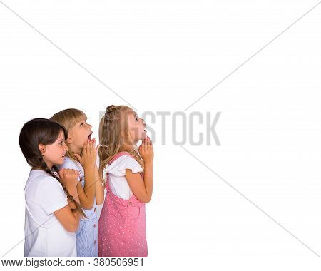 A Group Of Primary School Kids Girls Show Emotions Of Joy And Surprise. Isolated On White Background