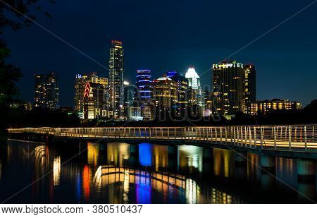 Austin Texas Nightscape Mirrored Reflections Of The City Lights Reflecting Off Of The Calm Waters Of