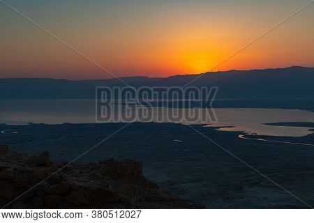Dawn Over The Mountains Of Jordan And The Dead Sea. View From The Territory Of The Ruins Of The Mass