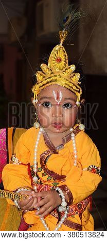 Delhi - India Aug 12th 2020 Indian Child Poses Or Dressed As Lord Krishna On Occasion Of Janmashtami