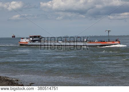 Terneuzen, The Netherlands, July 12, 2020, The Tanker An Inland Vessel Sails Under The Dutch Flag