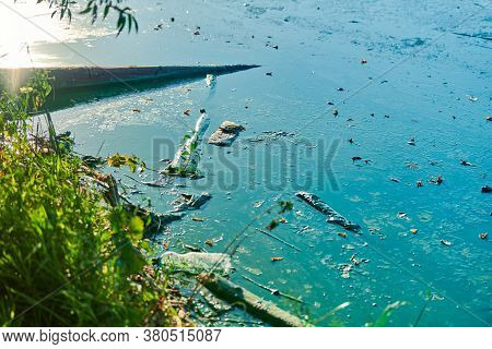 Environmental Water Pollution. Polluted River - Dirty Green Water, Garbage, Waste And Trash. Harmful