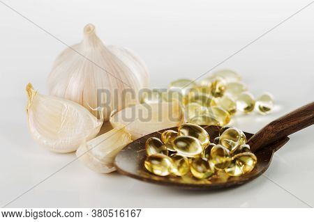 Garlic Gel Capsules Extract On White Background
