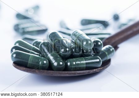 Spirulina Capsules Food Suplement On White Background