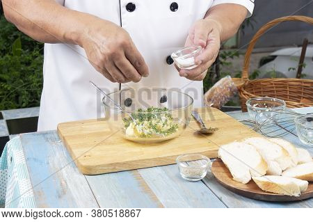 Chef Putting Salt To Bowl For Cook Garlic Bread / Cooking Garlic Bread Concept