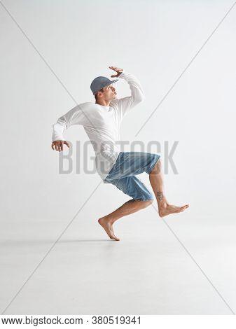 Cool Young Man Breakdancer Dancing Expressive Dance In White Studio. Dance School Poster. Breakdance