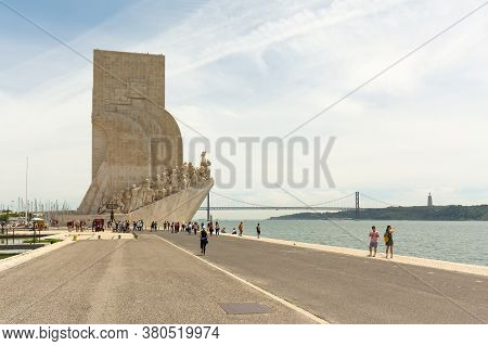 Lisbon, Portugal - 15th May, 2017: Tourists Flock Around And Over The Monument To The Discoveries (p