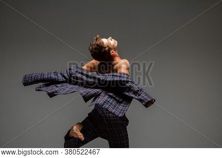 Stylish Young Guy Dancer In Suit Dancing Modern Expressive Dance In Studio. Dance School Poster. Dan