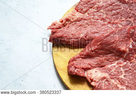 Tenderloin Of Fresh Beef Meat On A Wooden Board On A White Background