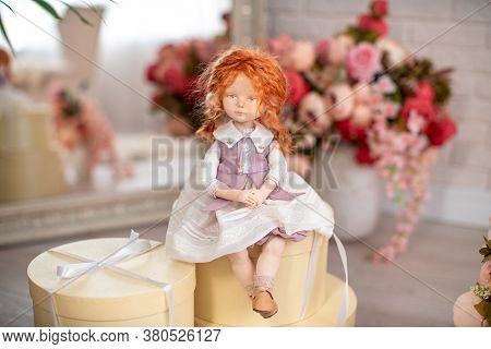 An Interior Design Doll With A Human Face , Made By Hand From Textiles, In A Retro Style , Sits On G