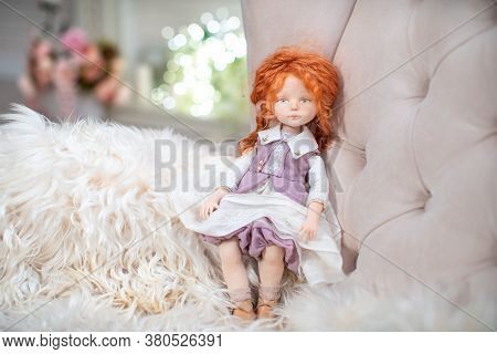 An Interior Design Doll With A Human Face , Made By Hand From Textiles, In A Retro Style , Sits On A