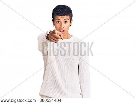 Young african amercian man wearing casual clothes pointing displeased and frustrated to the camera, angry and furious with you