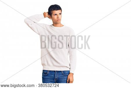 Young african amercian man wearing casual clothes confuse and wondering about question. uncertain with doubt, thinking with hand on head. pensive concept.