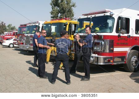 Firefighters At Command Center