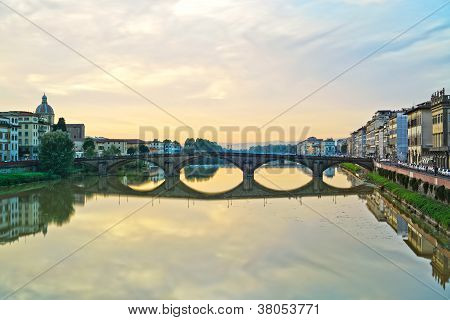 Carraia Medieval Bridge On Arno River, Sunset Landscape. Florence, Italy.
