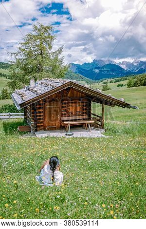 Woman On Vacation In The Dolomites Italy, Alpe Di Siusi - Seiser Alm With Sassolungo - Langkofel Mou
