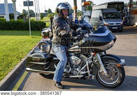 Europe, Poland, Sertember, 2014 - Biker On A Harley-davidson Motorcycle At A Gas Station In Poland,