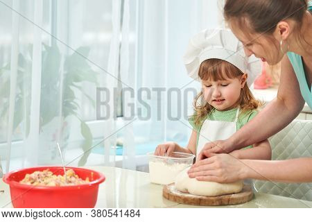 Happy Loving Family Are Preparing Bakery Together. Mom Teaching Child How To Cook Cooking Pie And Ha