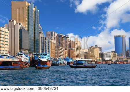 Dubai, Uae - December 9, 2017: Dhow Wooden Cargo Ships At Dubai Creek Port In Uae. Dubai Is The Most