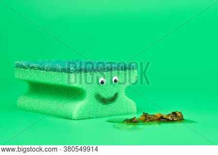 Funny Green Sponge With Eyes For Cleaning, Housekeeping And Washing Dishes. Fun Concept. Soft And Ha