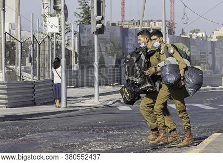 Jerusalem, Israel - August 6th, 2020: Two Israeli Soldiers, Carrying A Lot Of Gear And Wearing Covid