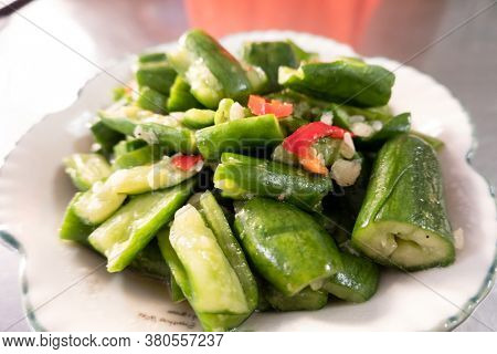 taiwanese snacks of  pickled cucumbers on a plate in a restaurant