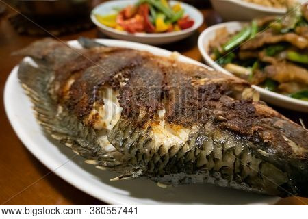 home-cooked meal of sauteed fish on the table