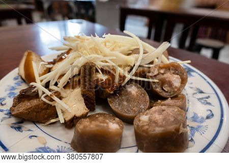 taiwanese special snack of sticky rice sausage on a plate