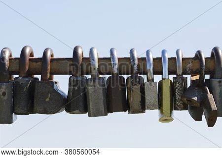 Closeup Of Many Love Locks On Iron Fence On The Blue Sky Background. Locks Of Love - Symbol Of Lover